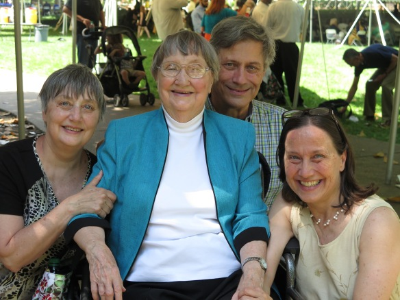 Mom's Team: my sister Juliana, Mom, my brother David, and me, at my niece's PhD ceremony. Life really does go on.